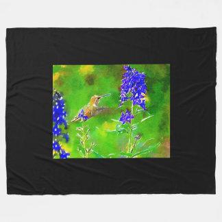 Gold green hummingbird, blue delphinium flowers fleece blanket