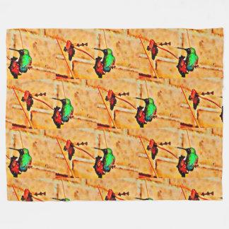 Gold green hummingbird, brick background fleece blanket