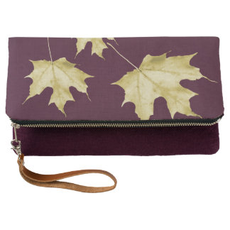 Gold leaves on burgundy clutch