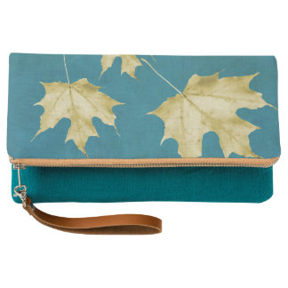 Gold leaves on teal clutch