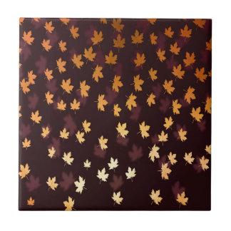 Gold Maple Leaf on dark red Tile