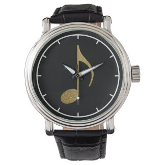 gold musical note on black watch