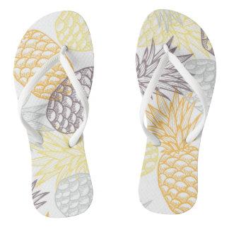 Gold pineapple flip flops