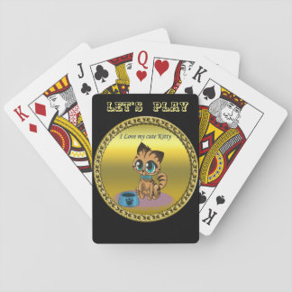 Gold playful fluffy cute kitten with cat eyes playing cards