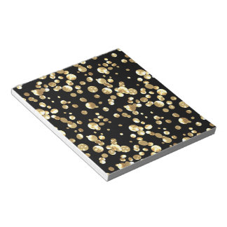 Gold polka dots on a black background . notepad