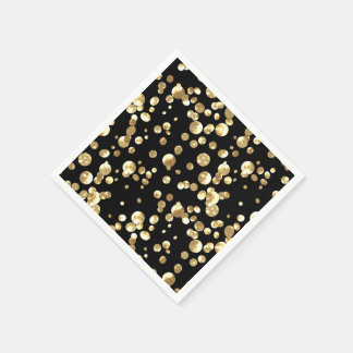 Gold polka dots on a black background . paper napkin