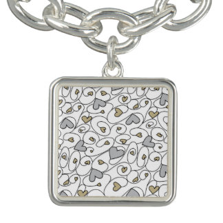 Gold & silver curly hearts charm bracelet