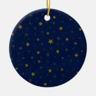 Gold sparkly stars on blue ceramic ornament