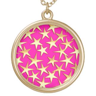 Gold stars on magenta pink pendant