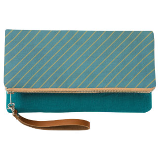 Gold stripes on teal clutch