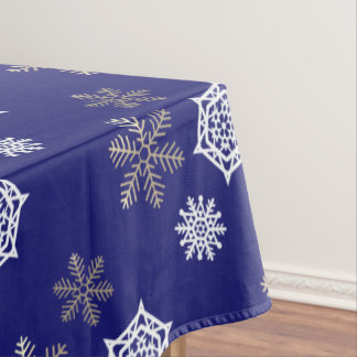 golden and white snowflakes against midnight blue tablecloth