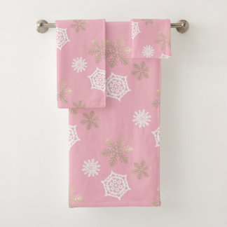 golden and white snowflakes against pale pink bath towel set