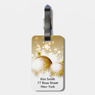 Golden brown new year decoration with snow luggage tag