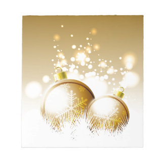 Golden brown new year decoration with snow notepad