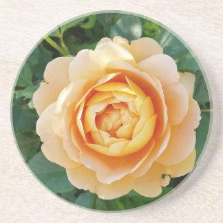 Golden colored rose coaster