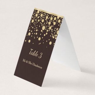 Golden confetti on brown Table number, place card
