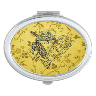 GOLDEN FLORAL MIRROR WITH LADY IN HAT & FEATHER TRAVEL MIRRORS
