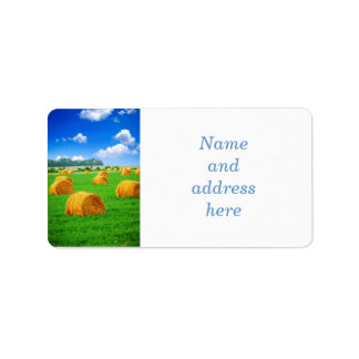 Golden hay bales in green field label