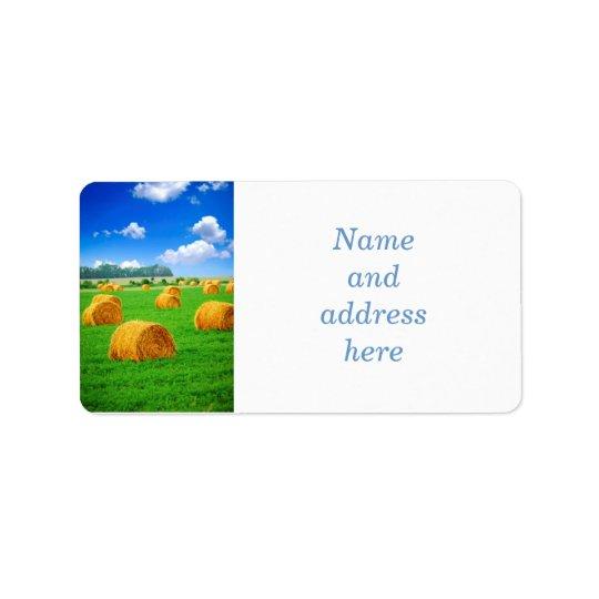 Golden hay bales in green field label