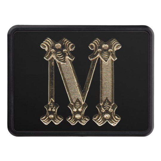 Golden Initial Letter M on Black Background Trailer Hitch Cover
