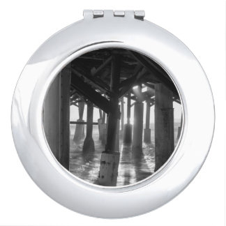 Golden Light Shines Through Grayscale Compact Mirror