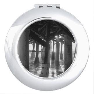 Golden Light Shines Through Grayscale Compact Mirror