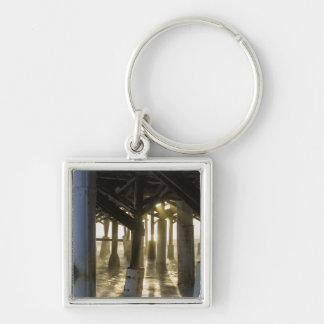 Golden Light Shines Through Silver-Colored Square Keychain