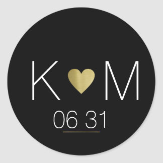 Golden love heart with couple names on black round sticker