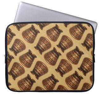 Golden mulberry leaf urn on sand laptop sleeve