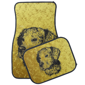 Golden retriever puppy portrait in black and gold car mat