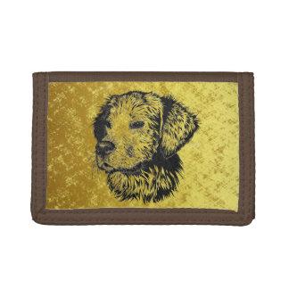 Golden retriever puppy portrait in black and gold tri-fold wallet