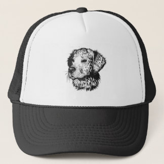 Golden retriever puppy portrait in black and white trucker hat