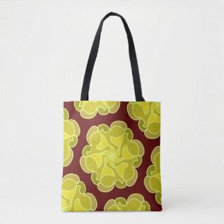 Golden rose on deep red tote bag