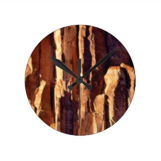 golden sandstone pillars round clock