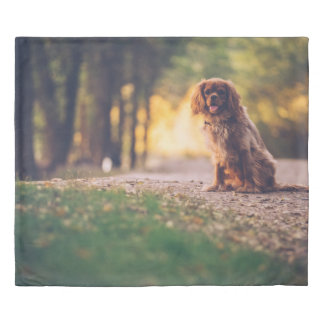 Golden Spaniel dog panting in the sun on path Duvet Cover