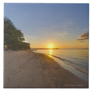 Golden Sun Ball Setting Over Tropical Island Ceramic Tiles