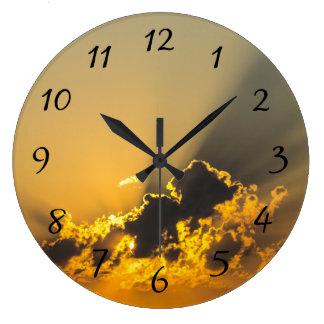 Golden Sunset Illuminating a Cloud Wall Clocks