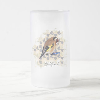 Goldfinch on leaf background. frosted glass beer mug
