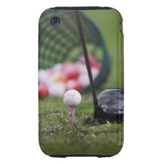 Golf ball on tee beside golf club iPhone 3 tough covers