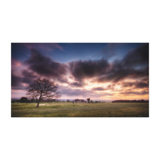 Golf course landscape with a red sunset sky canvas print