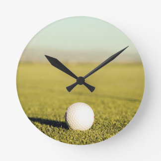 Golfball in the grass wallclock