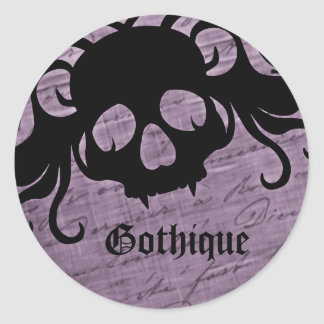 Gothic purple and black fanged skull classic round sticker