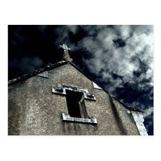 Gothic small church with cloudy sky postcard