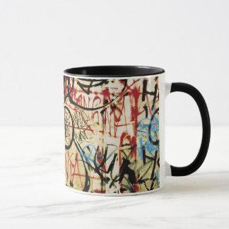 Graffiti on a wall mug