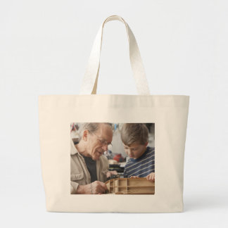 Grandfather And Grandson Work Together Large Tote Bag