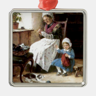 Grandmother and granddaughter sewing metal ornament
