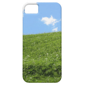 Grassy field at the rolling hill against the sky iPhone 5 cover