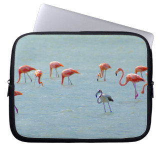 Gray and pink flamingos flock in lake laptop sleeve