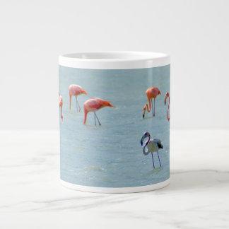 Gray and pink flamingos flock in lake large coffee mug