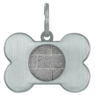 Gray brick wall background pet name tag